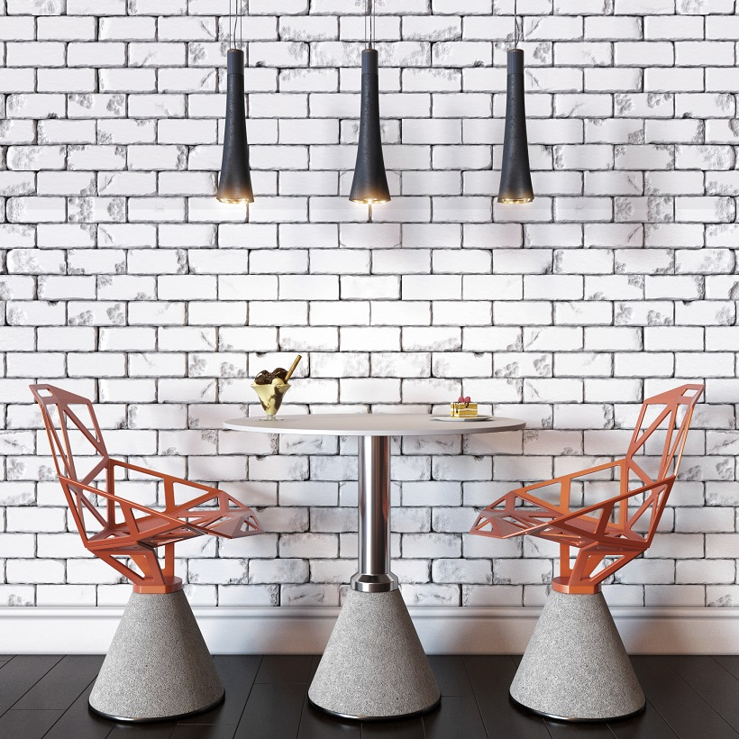 Home trends featuring a modern orange chairs against white brick wall.