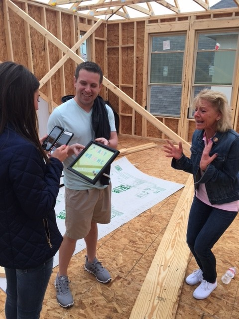 Couple makes new home announcement and baby announcement in new home being built.