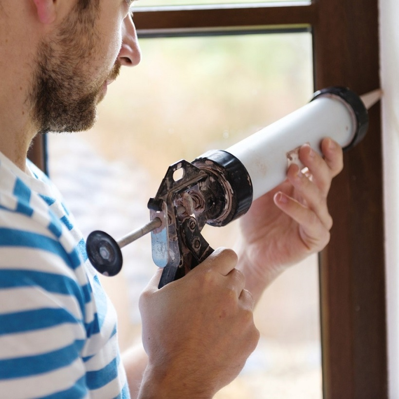 Caulking windows as one of the top home maintenance tips