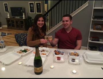 New homeowners enjoying dinner in a model home.
