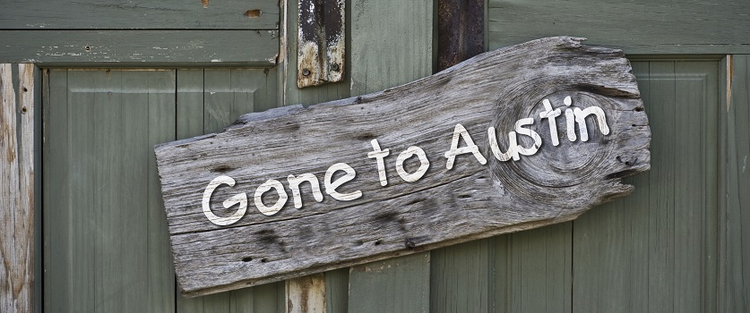 Sign on door about moving to Austin, Texas.
