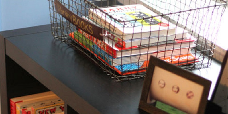 A back-to-school library station at home with baskets and shelves for school books.