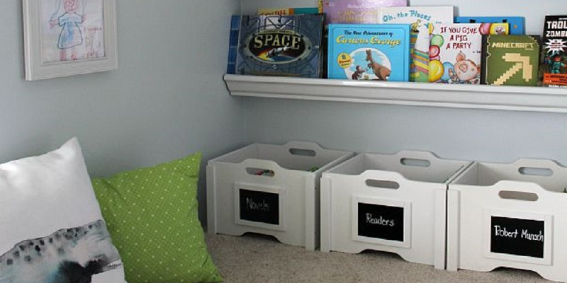Organized toy bins and shelves for books in a back-to-school-ready home.