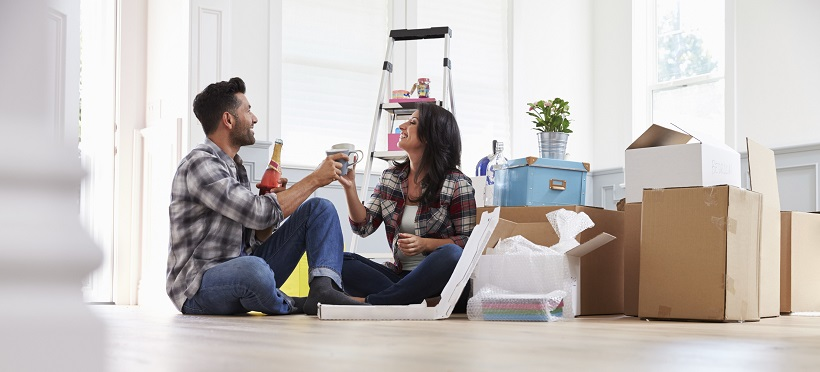 First-time homebuyers celebrating buying their new home