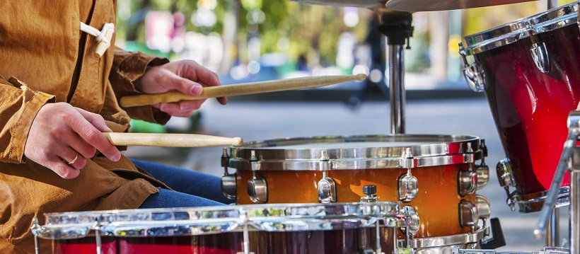 Man playing drums along Austin, Texas streets.