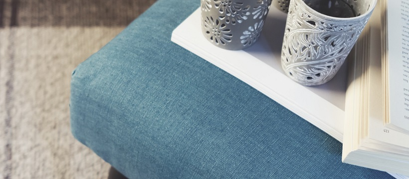 Blue cushion under book and cups as an autumn accent.