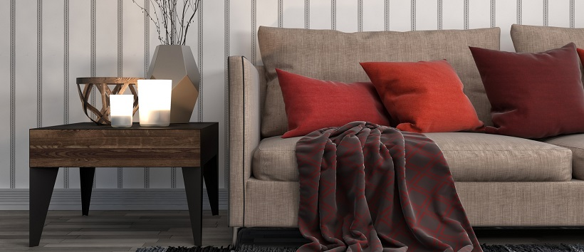 Shades of red pillows pose as autumn accents in this living room.