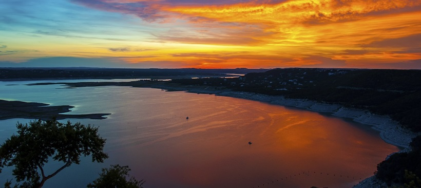 Sunset view of Lake Travis with lots of things to do in Cedar Park