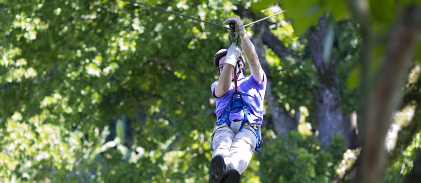 Man zip lining near Lake Travis as one of the things to do in Cedar Park