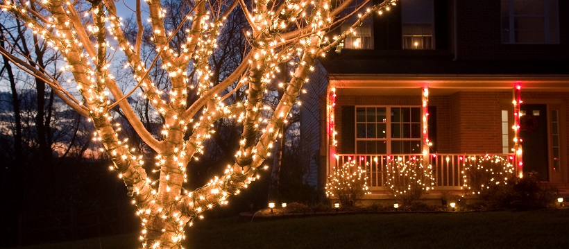 Christmas lights outside on a tree and around a porch - How To Hang Christmas Lights Outside Quick Guide
