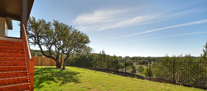 Hill Country backyard of a new home in the greater Austin, Texas, area