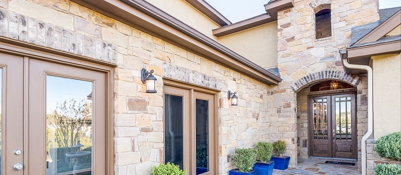Exterior of a new Austin home with brick and stucco