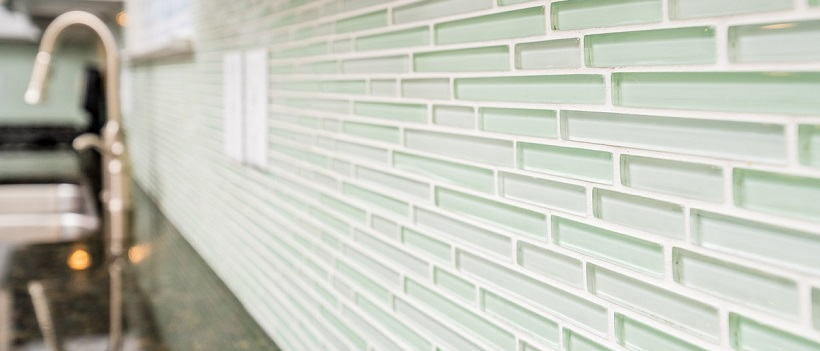 Close-up of mint green backsplash in the kitchen of a new Austin home