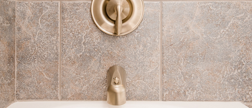 Close-up of golden bronze bathtub faucet in a new Austin home