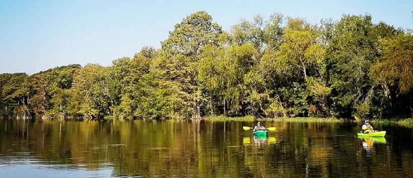 Kayakers enjoying the water and Hill Country in Buda, Texas