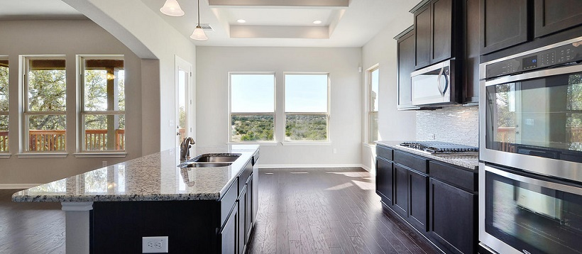 Cedar Park home with a contemporary kitchen opening up to a great Hill Country view.