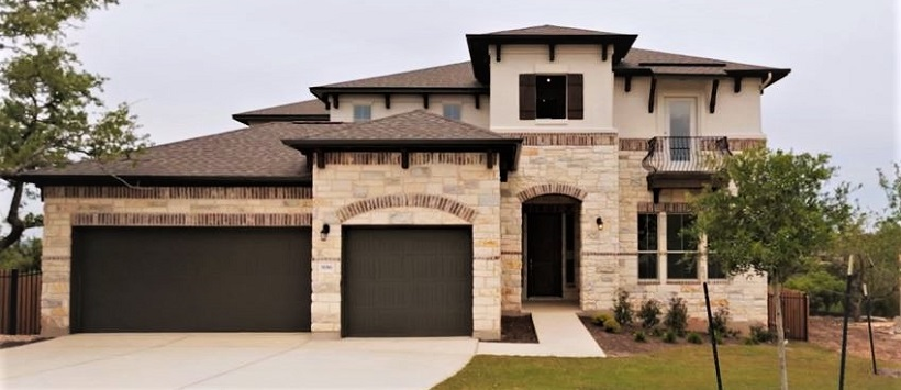 Cedar Park real estate example of the two-story stone and brick Lantana exterior at Trento.
