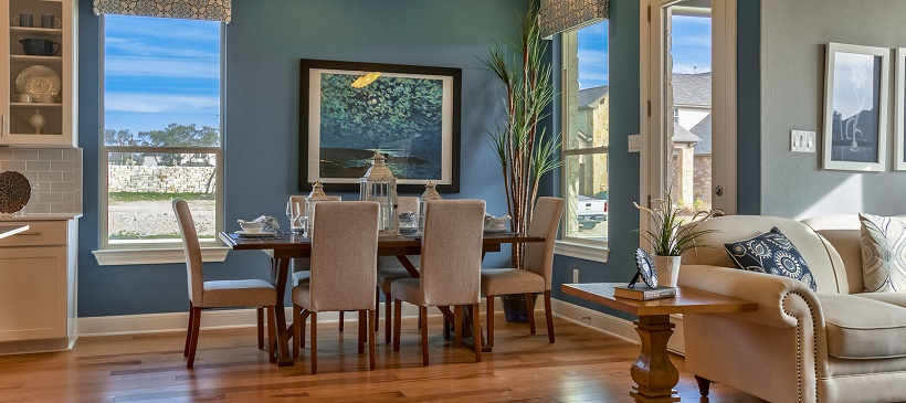 View of blue dining room near living room in this Cedar Park real estate option at The Park at Brushy Creek