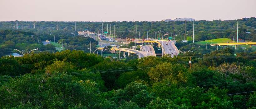 View of South Austin and highway surrounded by greenery and trees.