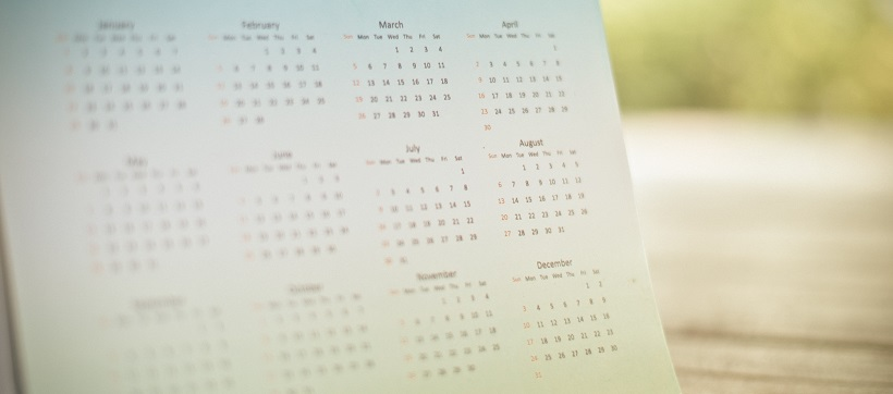 Faded image of a calendar showing each month of the year.