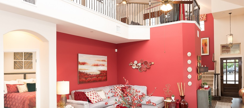 Fuchsia accent wall shows off a vibrant living room of an open-concept home.