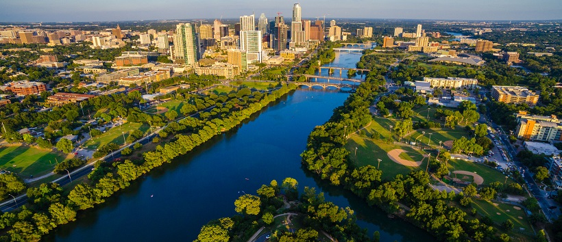 View over Town Lake and Zilker Park with the downtown Austin, Texas, buildings in the distance.