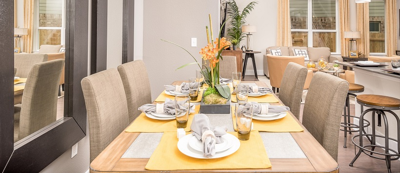 Dining room with fall paint colors and yellow placemats on a dining table.