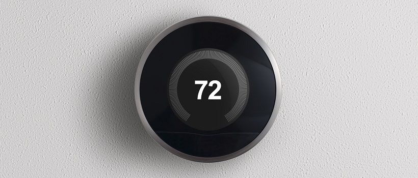 A black Nest Thermostat reads a temperature of 72 degrees Fahrenheit.