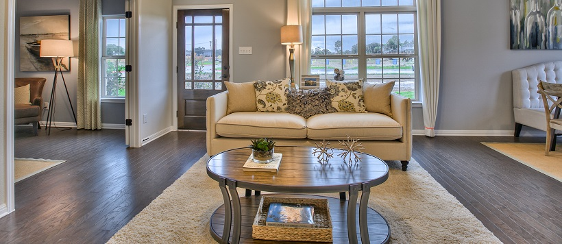 An open-concept living room leads into a nearby study area and a dining room.