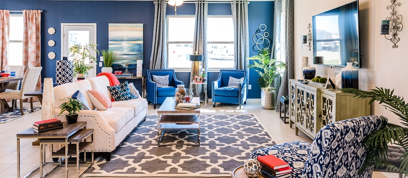 A bright blue accent wall showcases an open-concept living room of one of the best Austin, Texas, quick delivery homes.