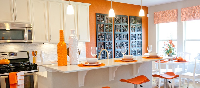The orange-and-white kitchen of one of the best coming-soon home options in Austin.