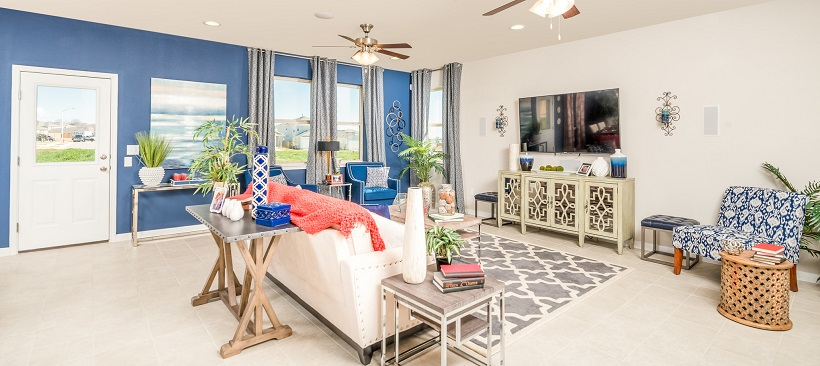 The vibrant living room of a coming-soon home option in Austin, Texas.