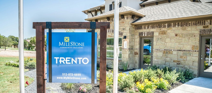Community sign in front of model home to represent one of the new Cedar Park homes in Trento.