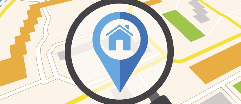 Vector image of a map with a magnifying glass enlarging a home icon.