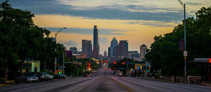 At sunset, view of downtown Austin and the capitol from the middle of South Congress.