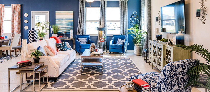 Vibrant living room with blue walls and decor